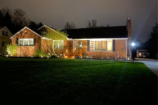 Ranch style home with low-voltage LED lighting in the garden and accenting the home.